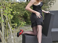 Sexy Milf Nylon Jane is out in the garden in a hot black lingerie and silky nylon stockings