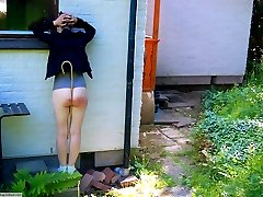 Her severely caned buttocks exposed to the public
