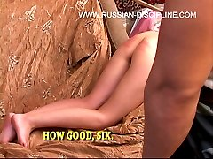 Hot russian brunette bending over for a mercilessly caning on her bared buttocks