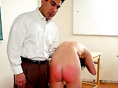 Beautiful student bending over table for spanking