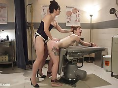 When Barbary Rose ended up in the emergency room after a mild car accident, she didn't expect to be treated by sexy doctor, Siouxsie Q. After Barbary is caught masturbating, Siouxsie punishes her with spanking, finger banging, choking, bondage, and vaginal and anal speculums! Barbary is rewarded with foot worship, pussy licking and an orgasmic vaginal and anal strap-on fucking!