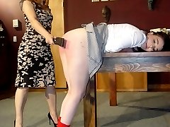 Disobedient schoolgirl facing the consequences