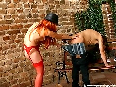 Beautiful redhead spanking her boyfriend