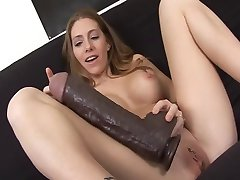 Pretty chick with monster dildo