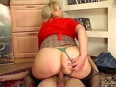 Busty fattie in a business casual outfit spreads legs and gets fucked during demo