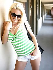Blond chick proudly shows off her camel toe in short shorts