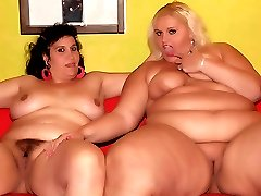 Two horny BBW with enormous breasts Melinda Shy and Rosa take turns eating out fat cunts