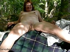 Plump mature exhibitionist out on the lake