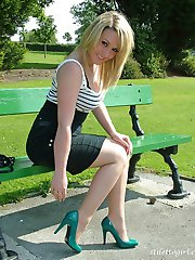 This naughty blonde is wearing a very short skirt and some gorgeous high heels