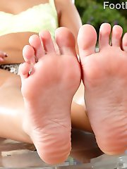Cleo Vixen has hired a photographer, and he wants to push the limits. He wants to get her toes...