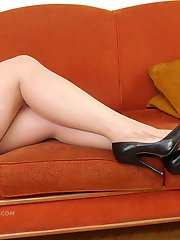 Hot leggy Milf Heidi is ready and waiting under her Christmas tree wearing a pair of tall black...
