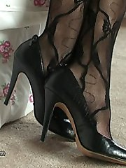 When a man has a fetish for ladies shoes the intensity of his passion is always expressed by his hardness at her shoes! It is always most enjoyable when the lady is attractive and has nice sexy legs. Here, Sofia adds to your pleasure by wearing a lovely lacy body stocking