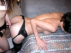 Horny lesbo gets fucked with a strap-on dildo