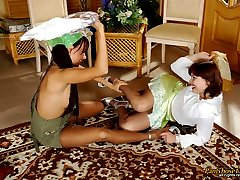Vivacious chicks in smooth pantyhose fighting for fun right on the floor