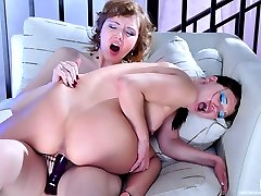 Lesbo co-workers exchange sensuous kisses before sharing a double dildo toy