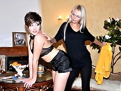 Sultry blonde pushes a brunettes thong aside aching to taste her wet muff