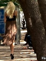 Our creeper is out with his camera. You know what he's looking for. If she isn't wearing any panties, he struck gold. A few minutes in, he spots Christi Anderson