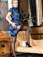 Slinky in oriental dress, Skye strips to reveal a black satin basque, holding sexy black fully...