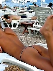 Gorgeous blonde Russian nudist sunbathes naked