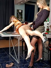 Naughty chick has got huge strap-on under her skirt for a sissy to suck on
