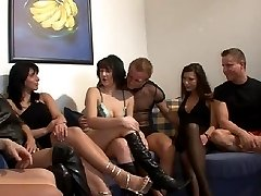Married couples swapping their partners during swinger orgy in private club