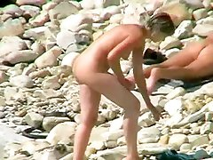 Seductive nudist walking along the beach. View her sexy body now