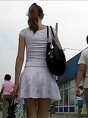 Girl wearing tan pantyhose up skirt