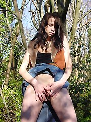 Brunette babe plays alone in the woods