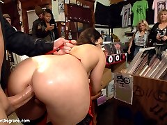 Bound in beautiful San Francisco, sex slave Wenona is made to walk the filthy streets in broad daylight. Searching for anything to wear and having no money to pay, Wenona offers up some oral deposits in exchange for the goods. Finally Wenona finds herself at a crowded record store, ready and willing to put on a show for the customers. John Strong is happy to flog, cane, and make Wenona his pet slave. She obliges him by getting all her holes filled and fucked. Don\'t we all wish we could work at that record store!