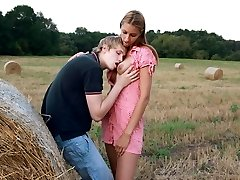 The soft bale of hay turns into the perfect location of these teen lovers. They can lean up...