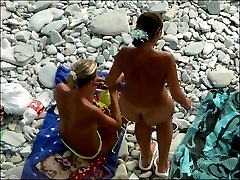 Nude beach girl slyly filmed solo and with a hot gal