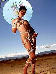 Colorful Goth girl in shibari rope bondage