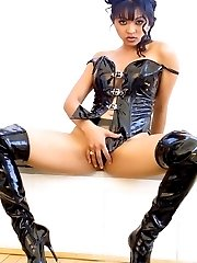 Hot Asian poses in black latex outfit and boots