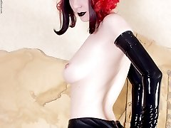 redheaded goth topless in rubber opera gloves skirt