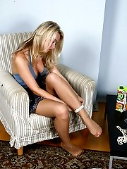 Tempting blonde worships and licks her pedicured feet in smooth pantyhose