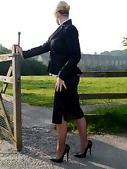 Sexy office girl Larissa takes a walk in the countryside after a day in the office still wearing...