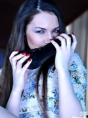 Nasty teaser dangles her stiletto pump before exposing pretty nyloned feet