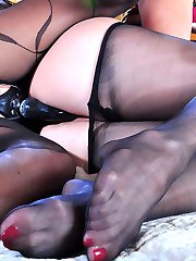 Pantyhosed babes use pedicured nyloned feet and a strapon in sapphic play