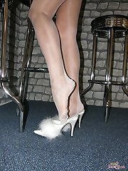 Nylon Jane wearing fluffy heels and sexy stockings