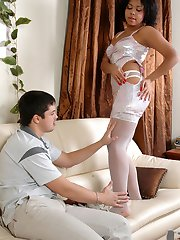 Stunning chick in white lacy stockings get a cum load on her shaved pussy