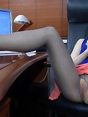 Sassy secretary takes a break for toy play having no panties under her hose