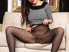 Estelle performs in her horny black net patterned pantyhose!