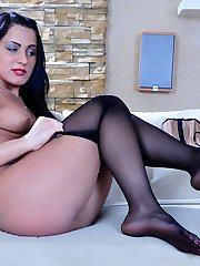 Teasing chick encases her pedicured feet into black tights before going out
