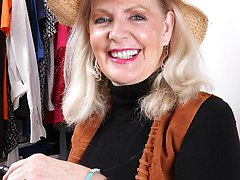 Busty older babe Judy Belkins spreads pussy in closet.