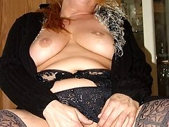 Fat blonde grandma Angela spreads her legs and shows cunt