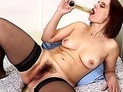 Horny housewife shows off hairy pussy