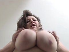 Horny mature licking her big nipples