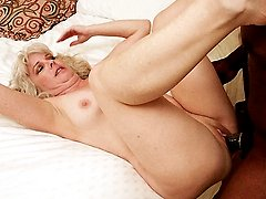 Blonde milf Stacey bounces on a huge black dick before she gets flipped on her back