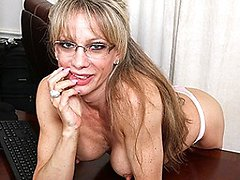 Horny American secretary playing with her dildo
