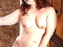 Curvy mature redhead Ember Rayne spreads pussy.